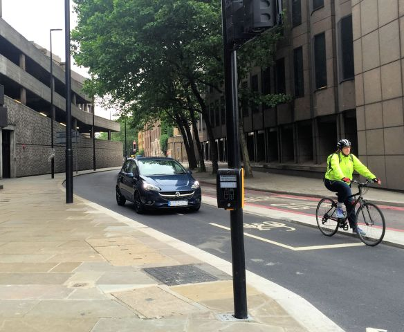 Car in Cycle Superhighway Shorter St-A